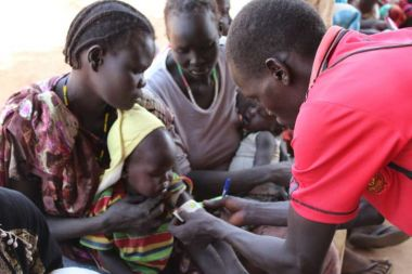 Mothers bring their mal-nourished children to a hospital in South Sudan.