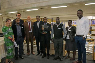 Guy Noel Mouoffo and Dirk Angemeer of action medeor present the warehouse in Germany to the colleagues from Malawi and Tanzania.