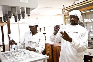 Two pharmacists analyse liquids in a laboratory in Tanzania.