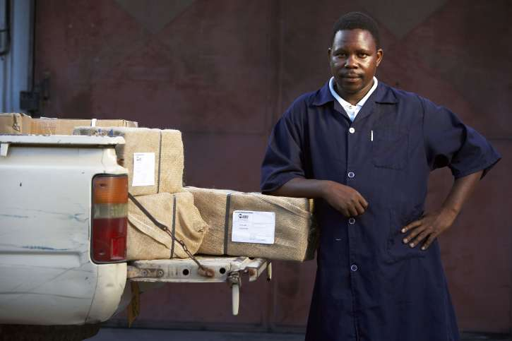 A man loads a pick-up with packages of action medeor.