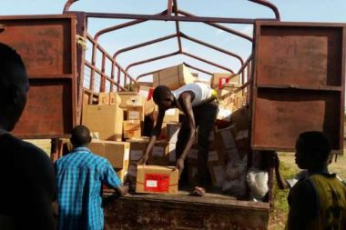 A delivery of medicines and medical supplies of action medeor is unloaded at our partner in Gumbo, South Sudan.