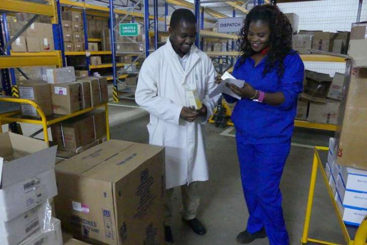 The employees of action medeor Malawi prepare a shipment for a customer.