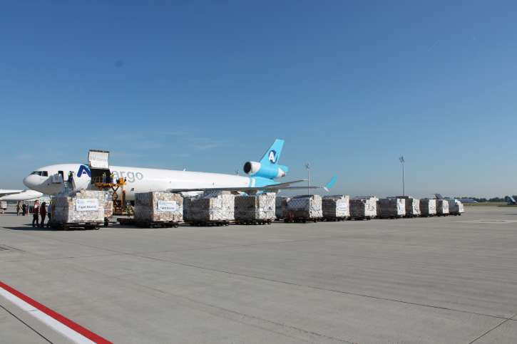 An emergency aid delivery of action medeor for those affected by the Ebola epidemic is loaded into the aircraft.