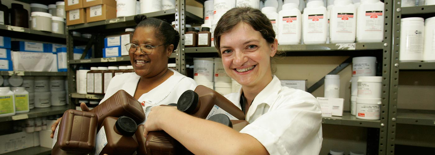 Two pharmacists work in the pharmacy in Guidotti Hospital, Zimbabwe.